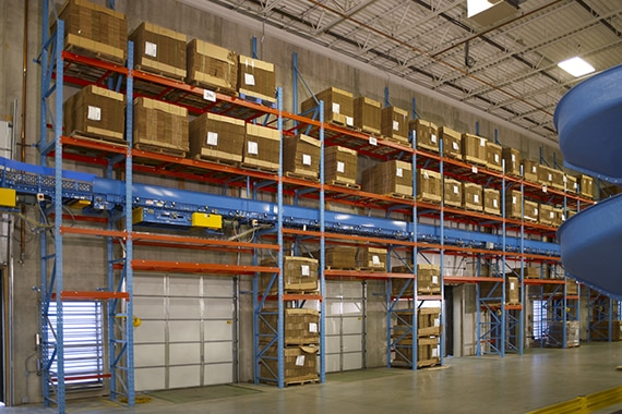 dock area with over dock racks loaded with empty pallets