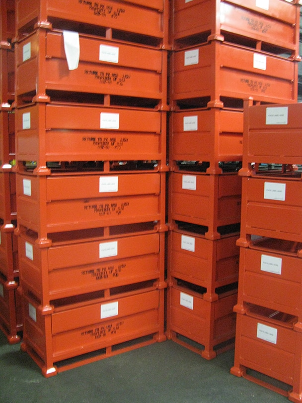 stacked steel containers with floor runners