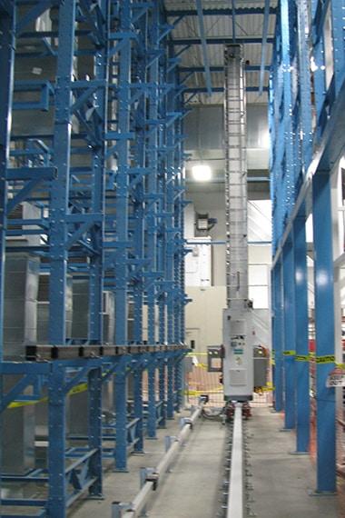 narrow rack aisle with crane